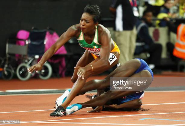 Murielle Ahoure of the Ivory Coast falls over Tori Bowie of the United States after Bowie won gold in the Women's 100 Metres Final during day three...