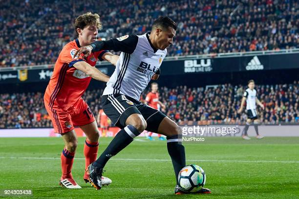 Murillo of Valencia CF competes for the ball with Odriozola of Real Sociedad during the La Liga match between Valencia CF and Real Sociedad at...