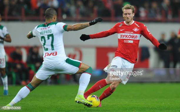 Murilo Cerqueira of FC Lokomotiv Moscow and Andre Schurrle of FC Spartak Moscow vie for the ball during the Russian Football League match between FC...