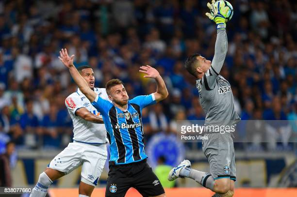 Murilo of Cruzeiro and Bressan and Marcelo Grohe of Gremio battle for the ball during a match between Cruzeiro and Gremio as part of Copa do Brasil...