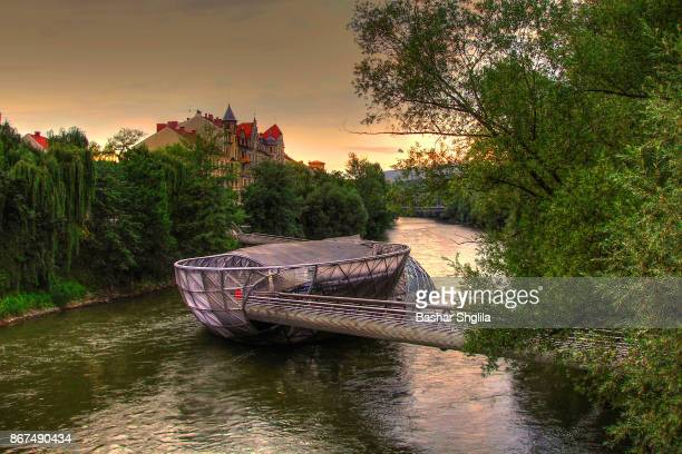 murinsel on mur river - graz stock photos and pictures