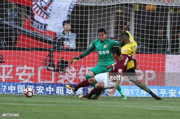 Muriqui of Guangzhou Evergrande and Yang Cheng of Hebei China Fortune compete for the ball during the Chinese Super League match between Hebei China...