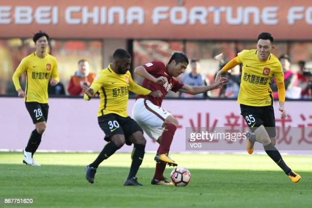 Muriqui of Guangzhou Evergrande and Zhao Mingjian of Hebei China Fortune compete for ball during the Chinese Super League match between Hebei China...