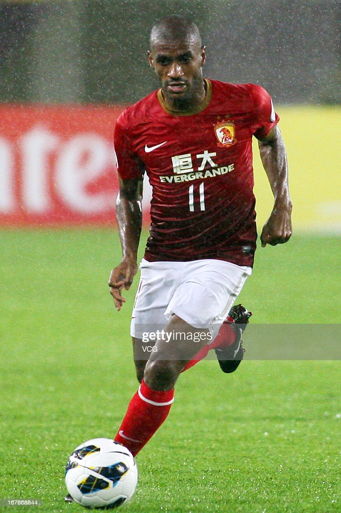 Muriqui #11 of Guangzhou Evergrande drives the ball during the AFC Champions League match between Guangzhou Evergrande and Jeonbuk Hyundai Motors at Tianhe Sports Center on May 1, 2013 in Guangzhou, China.