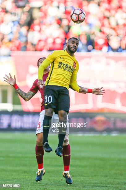 Muriqui of Guangzhou Evergrande heads the ball during the Chinese Super League match between Hebei China Fortune and Guangzhou Evergrande at...