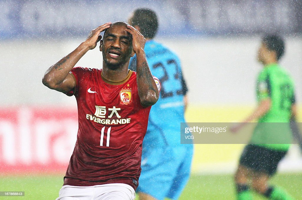 Muriqui #11 of Guangzhou Evergrande reacts after losing a goal opportunity during the AFC Champions League match between Guangzhou Evergrande and Jeonbuk Hyundai Motors at Tianhe Sports Center on May 1, 2013 in Guangzhou, China.