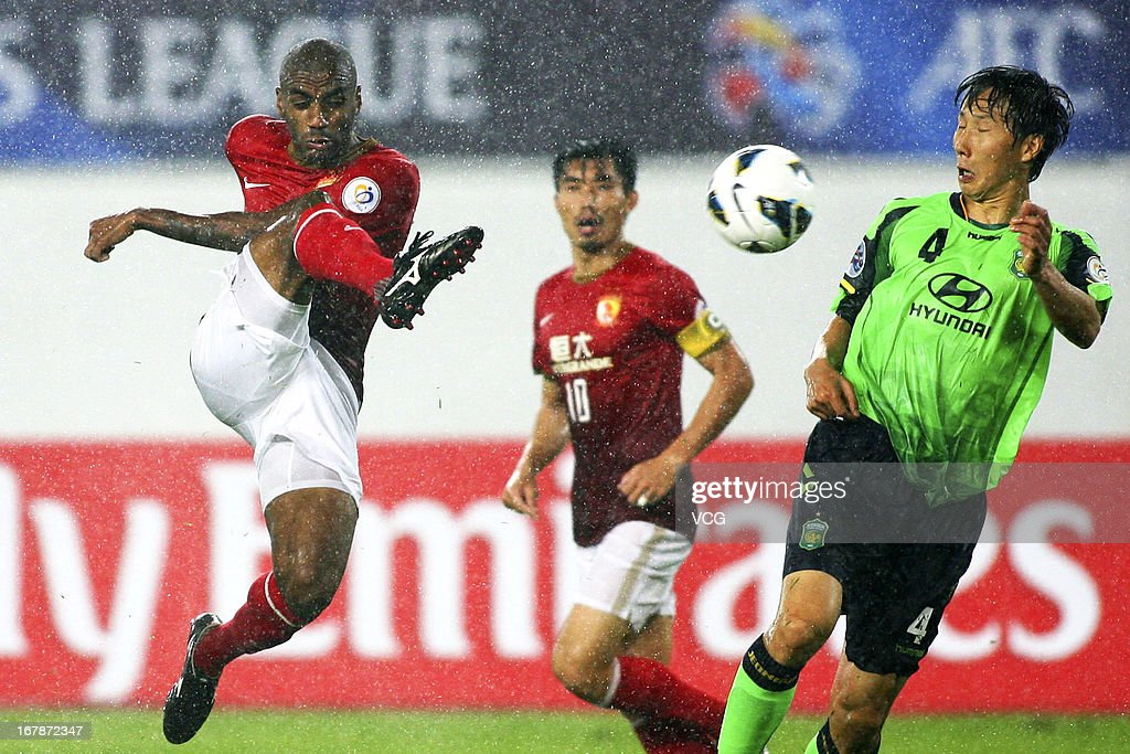 Muriqui #11 of Guangzhou Evergrande shoots the ball during the AFC Champions League match between Guangzhou Evergrande and Jeonbuk Hyundai Motors at Tianhe Sports Center on May 1, 2013 in Guangzhou, China.