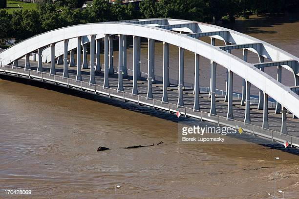 CONTENT] Murky waters of floodswollen Elbe pass below the older of two road bridges in city of Usti nad Labem in nothern Czech Republic