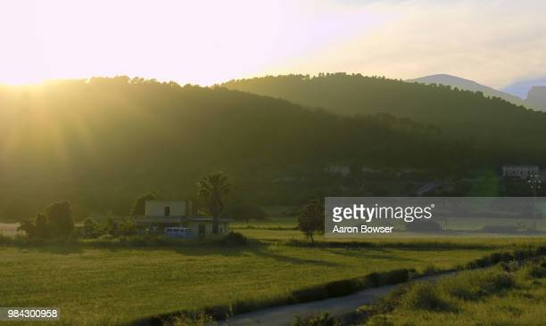 muro, spain sunset - muro stock photos and pictures