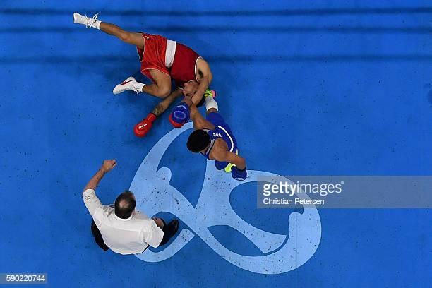 Murodjon Akhmadaliev of Uzbekistan celebrates after defeating Alberto Ezequiel Melian of Argentina by TKO the Men's Bantam 56kg Quarterfinal 4 on Day...