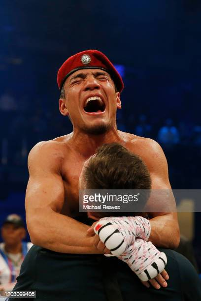 Murodjon Akhmadaliev of Uzbekistan celebrates after defeating Daniel Roman to win the WBA and IBF 122 World Title at Meridian at Island Gardens on...