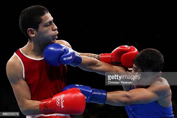 Murodjon Akhmadaliev of Uzbekistan fights against Alberto Ezequiel Melian of Argentina during the Men's Bantam 56kg Quarterfinal 4 on Day 11 of the...