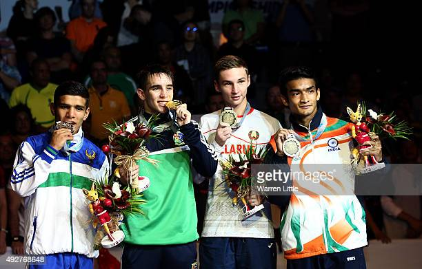 Murodjon Akhmadaliev of Uzbekistan Michael Conlan of Ireland Dzmitry Asanau of Belarusand and Shiva Thapa of India poses with their medals after the...