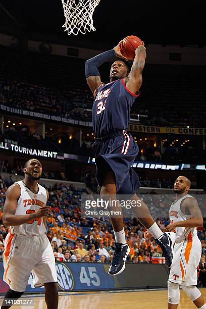 Murphy Holloway of the Mississippi Rebels dunks the ball over Jeronne Maymon of the Tennessee Volunteers during the quarterfinals of the SEC Men's...