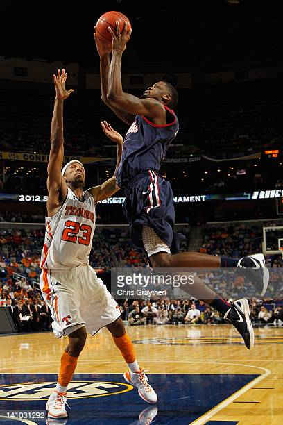Murphy Holloway of the Mississippi Rebels shoots the ball over Cameron Tatum of the Tennessee Volunteers of the Tennessee Volunteers during the...