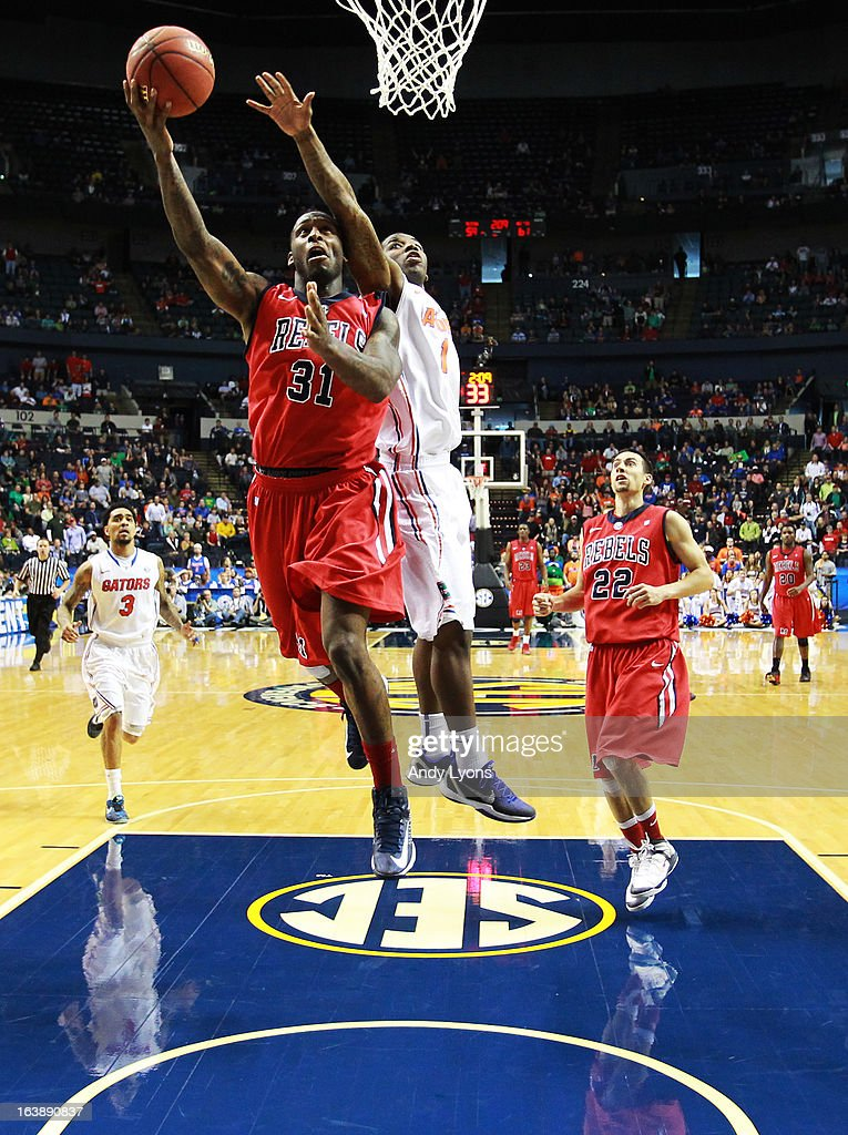 Murphy Holloway #31 of the Ole Miss Rebels goes up against Kenny Boynton #1 of the Florida Gators in the second half of the SEC Basketball Tournament Championship game at Bridgestone Arena on March 17, 2013 in Nashville, Tennessee.