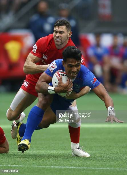 Murphy Paulo of Samoa is tackled by Justin Douglas of Canada during the Canada Sevens the Sixth round of the HSBC Sevens World Series at the BC Place...