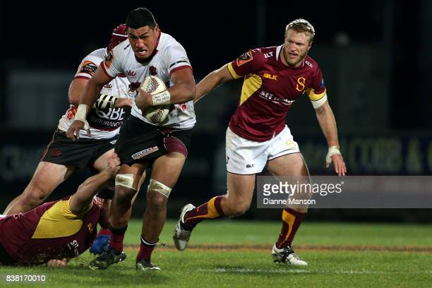 Murphy Taramai of North Harbour is tackled during the Mitre 10 Cup match between Southland and North Harbour at Rugby Park Stadium on August 24 2017...