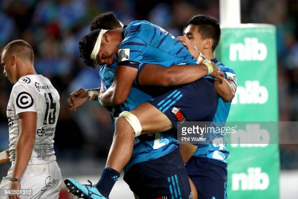 Murphy Taramai of the Blues congratulates Patrick Tuipulotu on his try during the round sevens Super Rugby match between the Blues and the Sharks at...