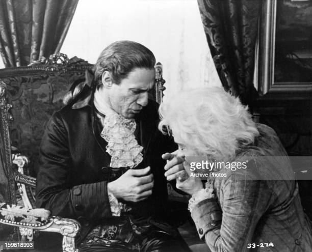 F Murray Abraham reacts as Tom Hulce kisses his hand in a scene from the film 'Amadeus' 1984