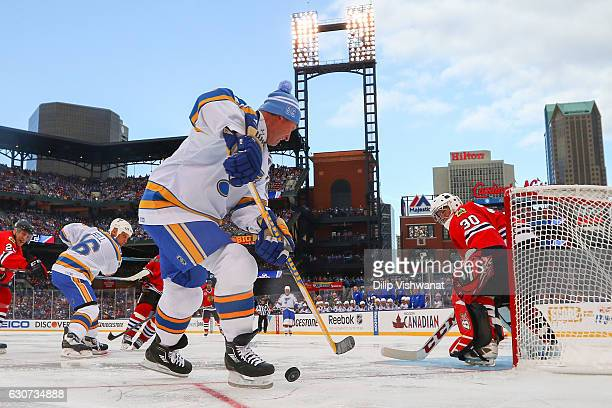 Murray Bannerman of the Chicago Blackhawks defends against Brett Hull and Wayne Gretzky of the St Louis Blues during the 2017 NHL Winter Classic...