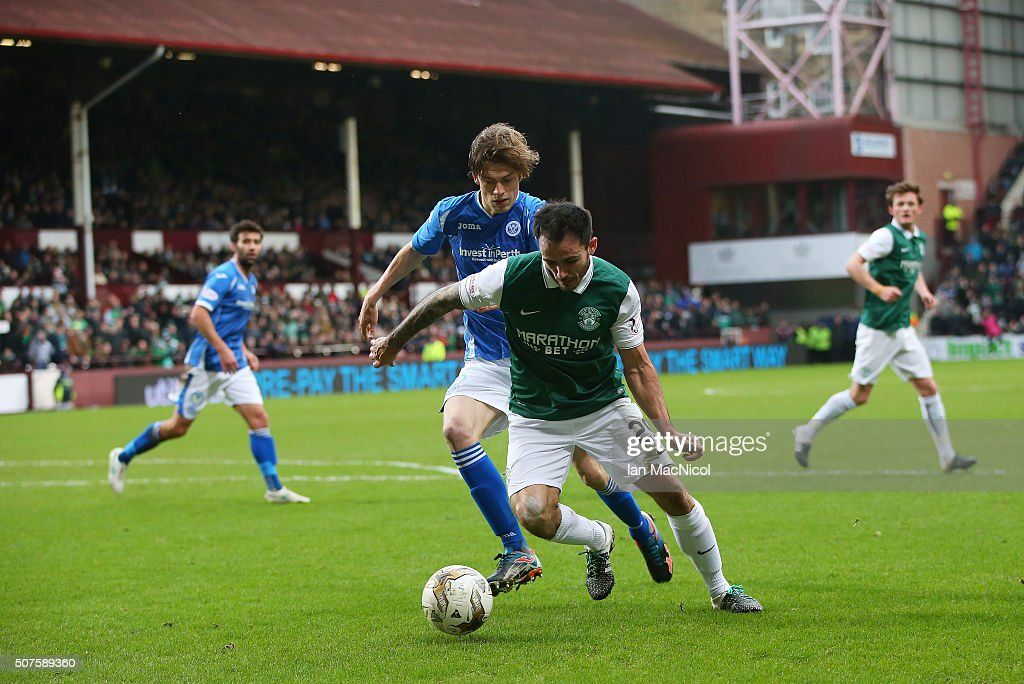 Murray Davidson of St Johnstone vies with Chris Dagnall of Hibernian during the Scottish League Cup Semi final match between Hibernian and St Johnstone at Tynecastle Stadium on January 30, 2016 in Edinburgh, Scotland.