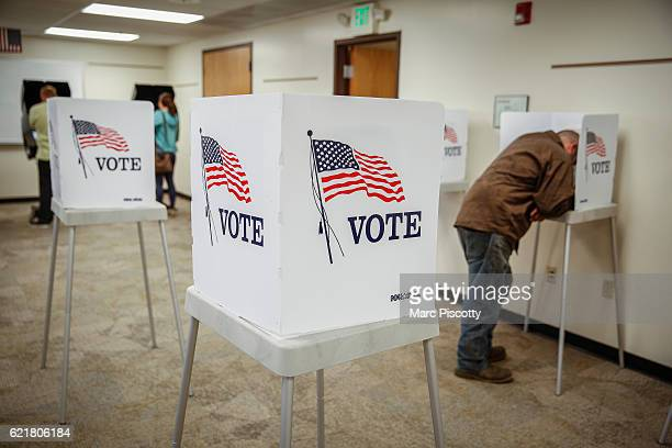 Murray Drohman of Golden Colorado fills out his ballot at the Jefferson County Fairgrounds on November 8 2016 in Golden Colorado Voters go to the...