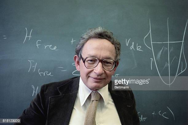Murray Hill, N.J.: Dr. Philip Anderson, using a blackboard at the Bell Telephone Laboratories, shows the equations that helped win him the Nobel...