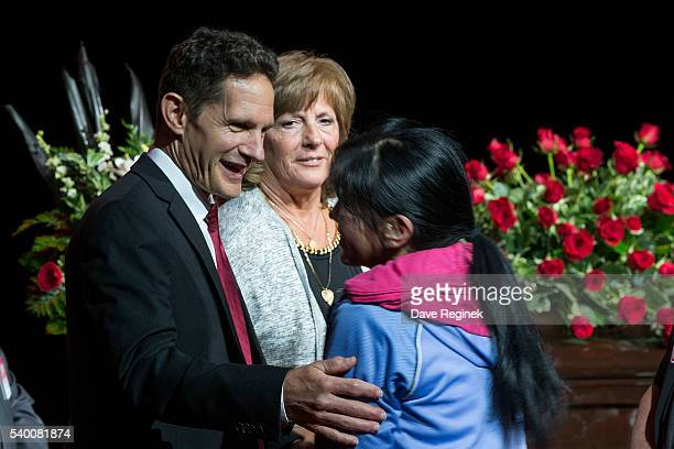 Murray Howe and Cathy Howe greet a fan paying their respects during the Gordie Howe Visitation at Joe Louis Arena on June 14 2016 in Detroit Michigan...