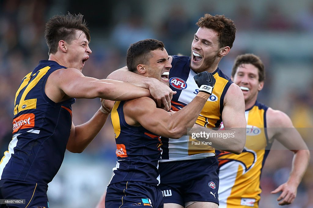 Murray Newman of the Eagles is congratulated by team mates after kicking a goal during the round 21 AFL match between the West Coast Eagles and Western Bulldogs at Domain Stadium on August 23, 2015 in Perth, Australia.