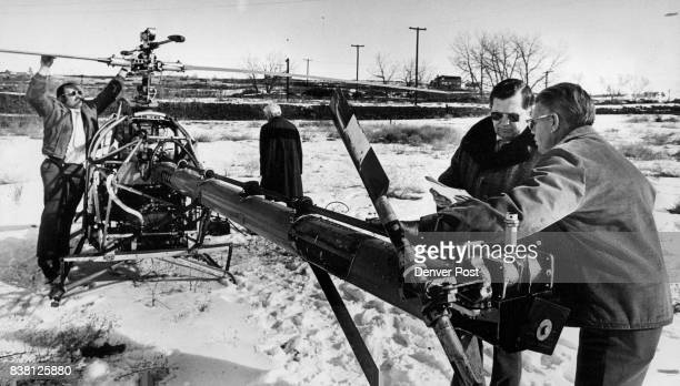 Murray right and Frank Kellogg check out Murray's helicopter Tuesday as test pilot Richard Lambert checks out the rotor before the machine was flown...