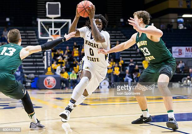 Murray State forward Terrell Miller Jr drives on Wright State forward Ryan Custer during an NCAA basketball game between the Murray State Racers and...