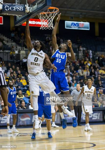 Murray State forward Terrell Miller Jr puts in a layup while covered by Eastern Illinois forward Aboubacar Diallo during the college basketball game...