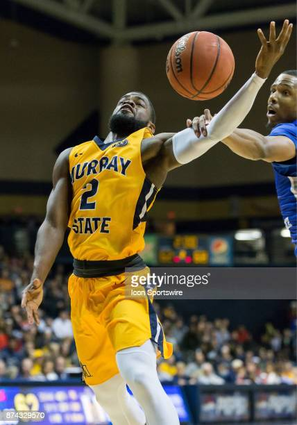 Murray State guard Jonathan Stark is fouled while making a layup attempt during the college basketball game between the Murray State Racers and...