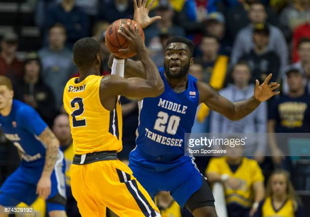 Murray State guard Jonathan Stark is guarded by Middle Tennessee guard Giddy Potts during the college basketball game between the Murray State Racers...