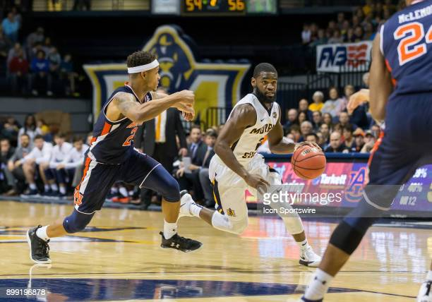 Murray State guard Jonathan Stark looks for a way to the basket against Auburn guard Bryce Brown during the college basketball game between the...