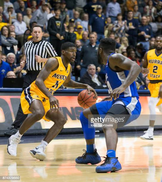 Murray State guard Leroy Shaq Buchanan makes a move on Middle Tennessee guard Giddy Potts during the college basketball game between the Murray State...