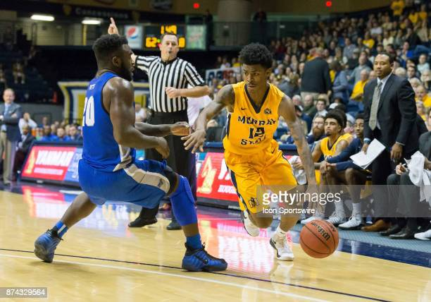 Murray State guard Temetrius Ja Morant looks to get around Middle Tennessee guard Giddy Potts and drive to the basket in the closing minutes of the...