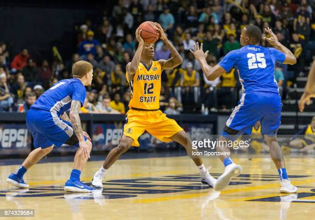 Murray State guard Temetrius Ja Morant looks to pass as he is double teamed by Middle Tennessee guard Tyrik Dixon and Middle Tennessee forward Karl...