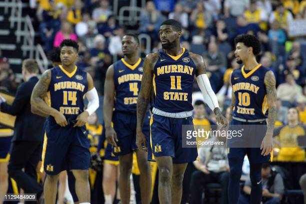Murray State Racers Guard Shaq Buchanan leads his team on to the court during the Ohio Valley Conference Championship college basketball game between...