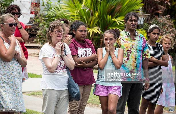 Murray Street residents stand on the side of the road as the funeral procession drives by for eight children that were killed in Cairns on January 10...