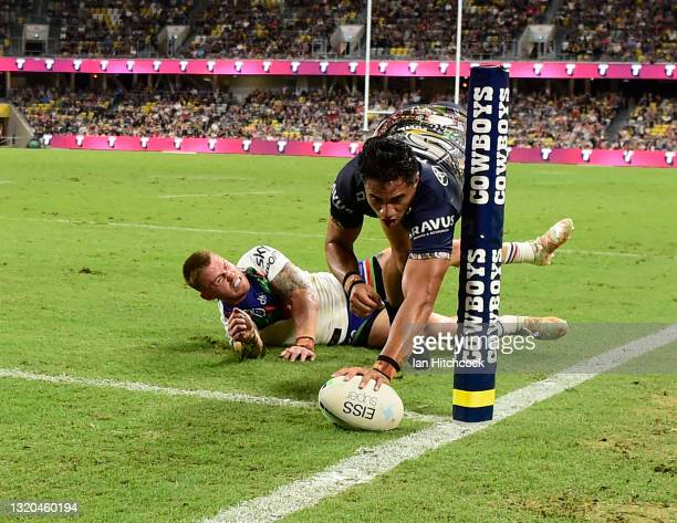 Murray Taulagi of the Cowboys scores a try during the round 12 NRL match between the North Queensland Cowboys and the New Zealand Warriors at QCB...