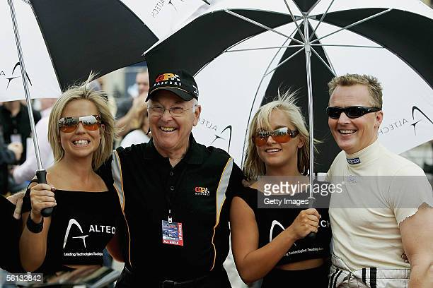 Murray Walker poses for a picture with F1 x 2 driver Johnny Herbert during a street demonstration prior to the inaugural Grand Prix Masters race at...