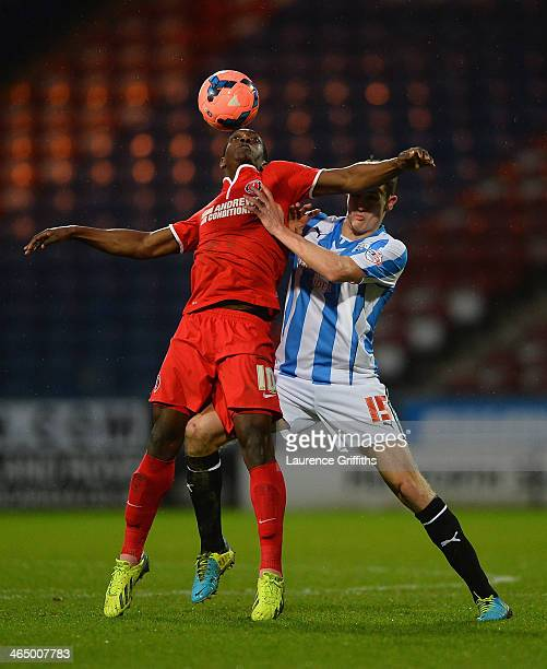 Murray Wallace of Huddersfield battles with Marvin Sordell of Charlton Athletic during the Budweiser FA Cup Fourth Round match between Huddersfield...