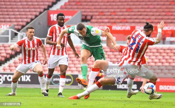 Murray Wallace of Millwall FC scores their team's first goal fast Steven Fletcher of Stoke City during the Sky Bet Championship match between Stoke...