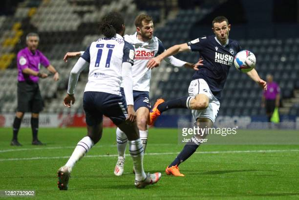 Murray Wallace of Millwall is fouled by Tom Barkhuizen of Preston North End leading to a penalty during the Sky Bet Championship match between...