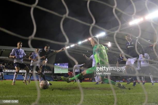 Murray Wallace of Millwall scores the winning goal during the FA Cup Fourth Round match between Millwall and Everton at The Den on January 26 2019 in...