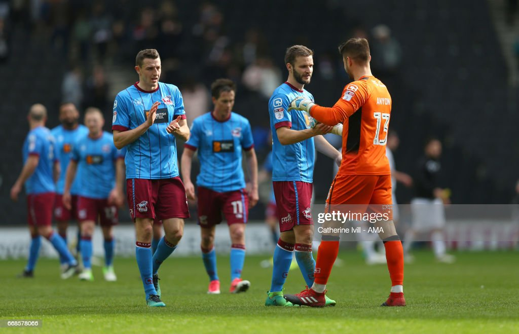 Murray Wallace of Scunthorpe United applauds as Scott Wiseman of Scunthorpe United congratulates goalkeeper Joe Anyon of Scunthorpe United during the Sky Bet League One match between MK Dons and Scunthorpe United at StadiumMK on April 14, 2017 in Milton Keynes, England.