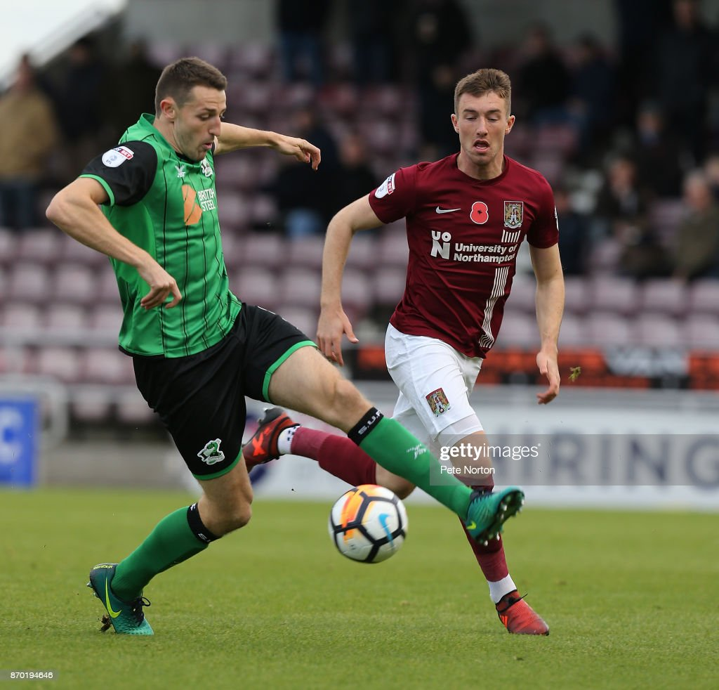 Murray Wallace of Scunthorpe United controls the ball watched by Chris Long of Northampton Town during The Emirates FA Cup First Round match between Northampton Town and Scunthorpe United at Sixfields on November 4, 2017 in Northampton, England.