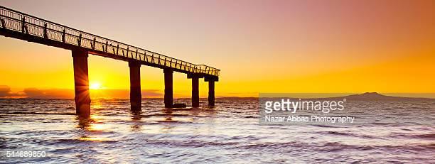 Murrays Bay Sunrise through Jetty
